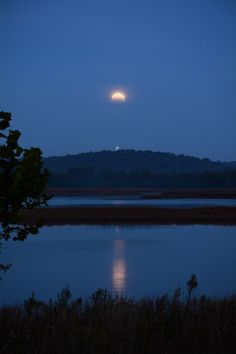 One of my favorite photos of the October 2014 eclipse.  This one was also taken near the end, and features the moon's reflection in Sahoma Lake.