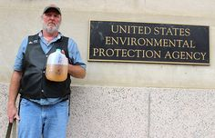 Ray Kemble of Dimock, Pennsylvania holds a jug of discolored water from his well, contaminated by nearby fracking operations while standing outside of the U.S. EPA building in Washington, DC. Photo credit: Food & Water Watch