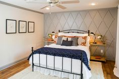 A large bedroom was also reconfigured, turning what had been an adjacent sitting area into an impressive new master bath, and creating this fresh and streamlined bedroom.