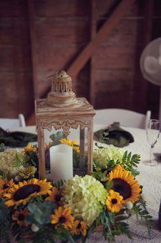 Sunflowers surrounding an awesome lantern!  Cool centerpiece idea for your wedding!