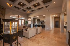 With amazing ceiling architecture, entertain your guests in this room with style. By Knipp Luxury