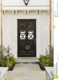 https://thumbs.dreamstime.com/z/detailed-wooden-front-door-white-brick-home-intricate-design-to-family-features-criss-cross-glass-patterns-house-39176770.jpg