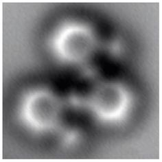 Almost as clearly as a textbook diagram, this image made by a noncontact atomic force microscope reveals the positions of individual atoms and bonds, in a molecule having 26 carbon atoms and 14 hydrogen atoms structured as three connected benzene rings. Credit: Lawrence Berkeley National Laboratory and University of California at Berkeley