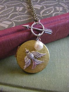 The Hunger Games Locket  Katniss Pearl by CHAiNGEthesubject