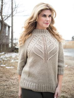 A stunning cable and eyelet yoke shapes the modified raglan in this seamless top down pullover. Stitch pattern is charted.