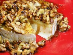 Honey Walnut Brie appetizer. I tried this for the first time at a party recently (served with french baguette slices). DELICIOUS! I had to fight for more because it was so popular. This recipe doesn't call for baking, but the hostess said she baked hers at 350 for about 5-8mins so the brie would be gooey & spreadable.