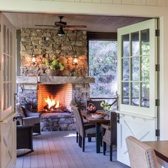 Who's ready for some autumn nights? This stone fireplace just makes us want to curl up by the fire. Where is your favorite mountain getaway spot? Get tons of cabin inspiration in our Southern Cottage special issue. Southern Cottage, Coastal Cottage, Rustic Cottage, House With Porch, Cozy House, Porch Fireplace, Deck With Fireplace, Cottage Fireplace, Fireplace Kitchen
