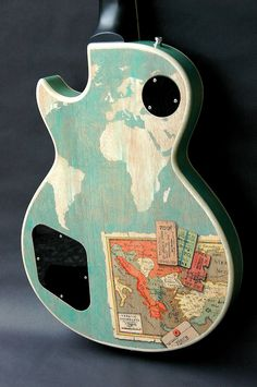 Love the idea of a map on a guitar. Especially if I can travel with that guitar!