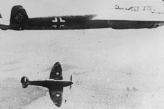 A British spitfire fighter plane, flying at 400 miles per hour, moving in on its target, a German 'flying pencil' bomber.