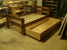 Twin Trundle Bed by OldWomansSplinterSho on Etsy, $327.00 (note to self- build a box w/ rollers on it to hold a twin mattress to slide under another twin mattress on a frame)