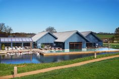 "A pool within a boating lake! And surely the world's most luxurious boathouse, housing a sauna and steam room, and where a 25m outdoor infinity pool is heated to 30 degrees year-round, surrounded by the beautiful [link url=""http://www.cntraveller.com/recommended/uk/best-of-the-cotswolds/viewall""]Cotswolds[/link] countryside, at [link url=""http://www.cntraveller.com/recommended/hotels/soho-farmhouse-oxfordshire""]Soho Farmhouse[/link]."