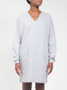 Boxy grey heather french terry V-neck with raglan sleeves by Kowtow. • Designer: Kowtow • Rib trim at neck and cuffs • Front slash pockets • Perfect for layering • Boxy, relaxed fit • 100% certified f