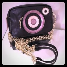 "NWT Betsey Johnson camera cross body bag Can we say oh Em Gee this is totally hot?? Yes!! This is a must-have statement piece! Measures at 8"" x 6"" x 2"" with a strap drop of 22 chain with shoulder comfort strap front side pocket zipper around where the lenses lip pull w/ signature embossed. Black faux leather exterior with a gold faux leather zip pull , Love Betsy by Betsey Johnson! Open interior room he will fit phone lipstick compact wallet and more stripe lining! I ship within one business…"