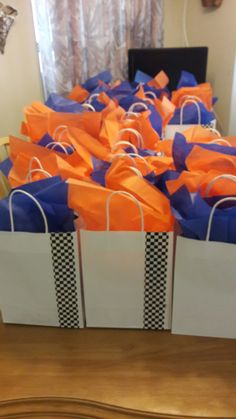 Dollar tree bags & checkered duck tape for Hot wheels birthday gift bags