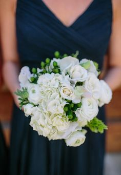 fresh #bouquet. Love the white  green + peacock feathers