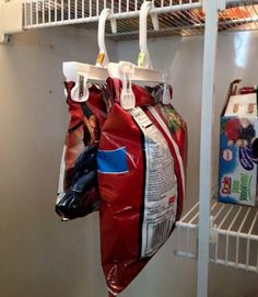 plastic pants hangers keep chip bags secured shut, seal the freshness in, and hang perfectly in the pantry