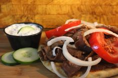 Gyros: Thinly sliced Beef and Lamb. Served with homemade Tzatziki Sauce.