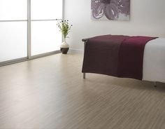Fine white zebrano flooring for a beautifully delicate-looking bedroom. Oak Laminate Flooring, White Oak, Home Interior, Entryway Bench, Ottoman, Delicate, Interiors, Bedroom, Chair