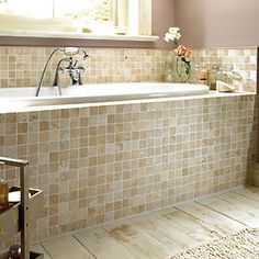 Natural travertine stone is cut into tiles before being tumbled to soften the surfaces and edges, producing a more rustic appearance. Travertine Bathroom, Bathtub Tile, Stone Bathroom, Tile Bathrooms, Small Bathrooms, Master Bathroom, Mosaic Wall Tiles, Wall And Floor Tiles, Tile Around Tub