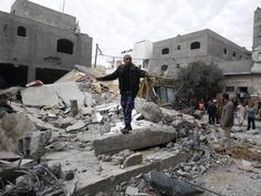 A man stands amist the rubble of an Israeli air strike on Saturday on a building in the Jebaliya refugee camp in the northern Gaza Strip. Israel bombed the Hamas-ruled Gaza Strip with more than 180 airstrikes early Saturday. Source: Hatem Moussa, AP