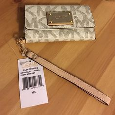 Brand New Michael Kors iPhone5 Clutch Brand New with Tags Michael Kors iPhone5 Clutch/Wallet. This has never been used, has a minor scratch on right bottom corner of gold plate (as shown in photo). Michael Kors Bags Clutches & Wristlets