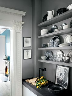 Gray Coat from Ralph Lauren Paint's Greenwich Village palette creates a cool and calm backdrop in an open-shelf kitchen