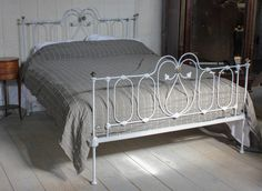 Pretty king size Victorian iron bedstead with little brass detail