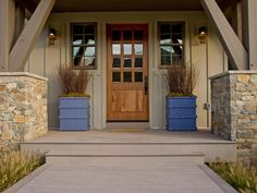 Custom-crafted planters flank the home's formal front entrance. The handiwork of carpenter David Brown, the pillars, trimmed in decorative nailheads, bring some bling to the front porch.