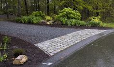 Gravel driveway with stone apron - this would be just past the deep & wide square concrete culvert in the drainage ditch next to the blacktop road. Maybe some of those light absorbing bricks to mark it for night.