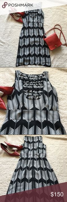 "Tory Burch 100% Silk Dress Midi, size 2 Tory Burch 100% silk midi dress in a black, white and gray chevron pattern with a ruffled bib, fitted waist, and zip up back. Not much stretch to this beauty. Fits true to size. In excellent used condition from a smoke-free, pet-free home. Bust: 16.5"" Waist: 13"". Size: 2 Tory Burch Dresses Midi"