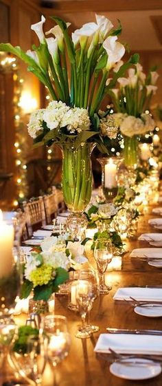 Tall calla Lilly centerpieces for long wedding table Calla Lily Centerpieces, Party Table Centerpieces, Tall Centerpiece, Tall Vases, Dessert Tables, Calla Lily Wedding, Wedding Bouquets, Wedding Flowers, Flower Bouquets