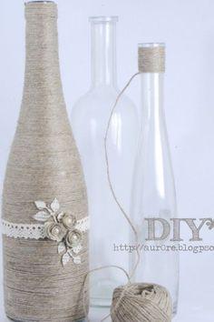 Leuk idee voor oude flessen! Vind je dit nou een saaie kleur? Probeer eens gekleurde wol, ziet er super leuk uit!
