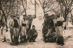 World War I. French soldiers posing near their snowman (France). Ca. 1916.