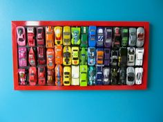 "25 Cute DIY Wall Art Ideas for Kids Room Fantastic way to keep all those ""matchbox"" size cars off the floor; I suggest using a magnetic back board that way your little one can remove, replace and change the look of this piece each time they play"