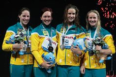 (L-R) Silver medal winners Alicia Coutts, Kylie Palmer, Brittany Elmslie and Bronte Barratt of Australia celebrate on the podium after the Swimming Women's Freestyle 4x200m Final on day thirteen of the 15th FINA World Championships at Palau Sant Jordi on August 1, 2013 in Barcelona, Spain.