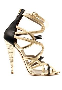 Versace gold  and black strappy heeled sandals with a layered gold heel and a black leather heel back.