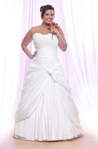 This strapless wedding gown has gathers and pick ups in the skirt. See other plus size wedding dresses in our collection.