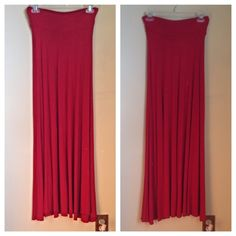 Red maxi skirt Comfy and flowy red maxi skirt. Only worn a couple of times. It's a bit tight on my  and could fit a size 2-4-6. Lots of stretch! Forever 21 Skirts Maxi