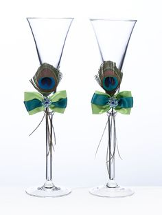 Make your first toast with these beautiful Peacock Wedding Toasting Glasses. Peacock toasting flutes each have a bow made from vibrant colors or blue and green along with a beautiful peacock feather. Wedding Toasting Glasses, Wedding Flutes, Toasting Flutes, Champagne Glasses, Wedding Favors, Rose Champagne, Wedding Champagne, Wedding Gifts, Peacock Theme