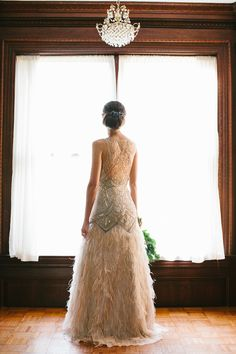 Sparkly dress with feathered skirt by Sue Wong, image by Taken by Sarah Photography.