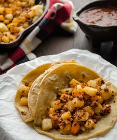 Potato and chorizo tacos. Serve the crispy bits of spicy chorizo mixed with the slightly golden potatoes on a warm tortilla and top with salsa.