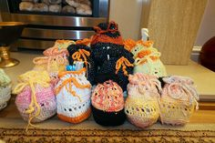 Crochet pouches for Halloween. I made little pouches with leftover yarn to fill with candy and hand out to trick or treaters. The bags were a hit! We also added little hama bead creations of ghosts, skulls and bats in the little bags. Here's the link to the free pattern: https://elisabethandree.wordpress.com/2013/08/01/little-pouch-pattern/