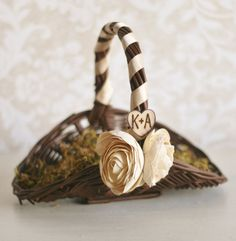 Personalized Rustic Chic Wedding Decor Flower Girl Basket With Engraved Wood Heart Charm Vintage Style Roses Moss Twigs Shabby Sweet. $39.99, via Etsy.