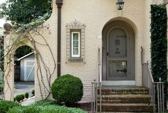 Love the door & wrought iron window frame