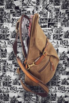 What offers chemical free water resistance while allowing the fabric to breath naturally? The Nomad Sling is a handmade retro styled sling with a modern twist. Click the link. Canvas Travel Bag, Travel Bags, Sling Backpack, Sling Bags, Commuter Bag, Day Bag, Fashion Handbags, Bag Making, Cotton Canvas