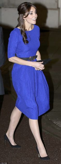 The Duchess of Cambridge today highlighted the invaluable role of foster carers as she attended an awards ceremony in London, wearing a beautiful cobalt blue dress