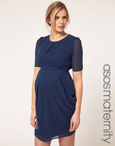 ASOS Maternity Tulip Dress  $63.63  Tulip dress by ASOS Maternity. Crafted in a lightweight chiffon fabric. Featuring a round neckline with a stitched pleat to the front, sheer puff sleeves with buttoned cuffs, a flattering empire line cut, double layered tulip skirt with draping to the side and a keyhole button fastening and a shirred elasticated panel to the reverse with an adjustable self-tie fabric fastening.