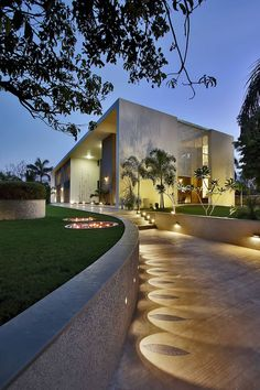 Landscaping Design Idea - Lights Highlight A Decorative Element On A Path