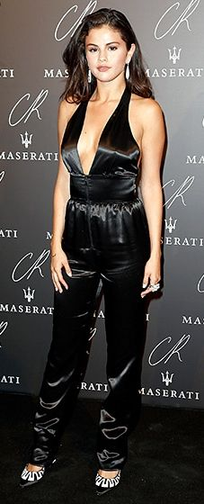 Selena Gomez echoed the glam of the '70s in a plunging black satin jumpsuit by Louis Vuitton. Black and white pumps and diamond tear drop earrings completed the look.