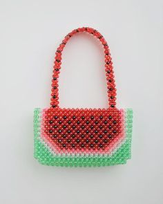 An eye-catching, sweet treat and addition to your summer wardrobe. Introducing an intricately beaded handbag from NY based designer, Susan Alexandra (learn more about the designer here). Influenced byFrida Kahlo, Oilily patterns from the 90's, heartbreak, empathy, bodega signs, watermelon candies, and hip-hop, Susan's colorful style is lush, romantic, and whimsical.  Each bag is beaded by hand in Manhattan's Chinatown and features over 450 beads. Unlined.  Measurements:5.5&...